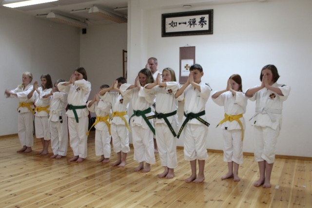 The kenshi that graded (and attended practice on Tuesday do gasshō rei to their fellow kenshi after receiving their bukai sodeshō after they passed their grading.