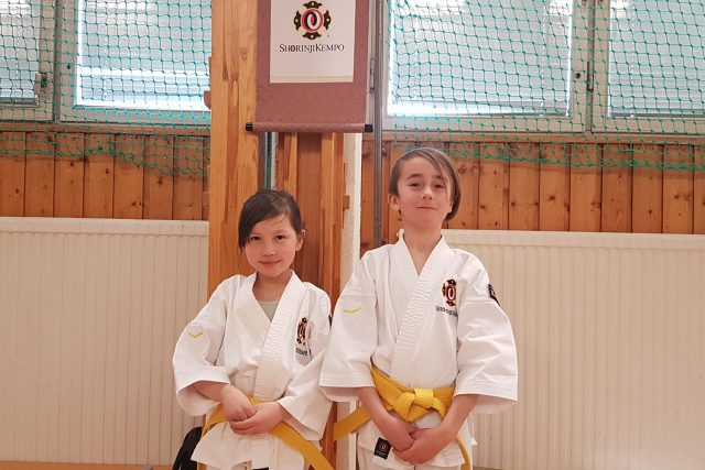 Emmie and Douglas after their successful grading to 7 kyū.